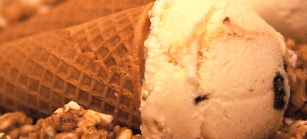 Rum Raisin Ice Cream in waffle cones absolutely buried in granola!